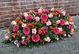 Rouwarrangement roze/paars/rood_